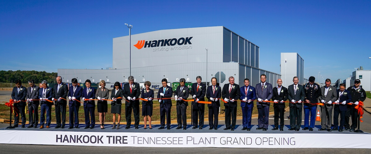 Hankook executives and government officials cut the ribbon to officially open the Tennessee Plant.